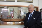 Dannevirke Rotarian Don Stephenson with the model Viking ship which will be displayed in the businesses who are the major sponsors of this year's Spring Festival. Photo / Christine McKay