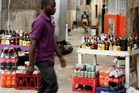 Stacks of liquor are sold on the streets of Maputo, Mozambique. Photo / AFP