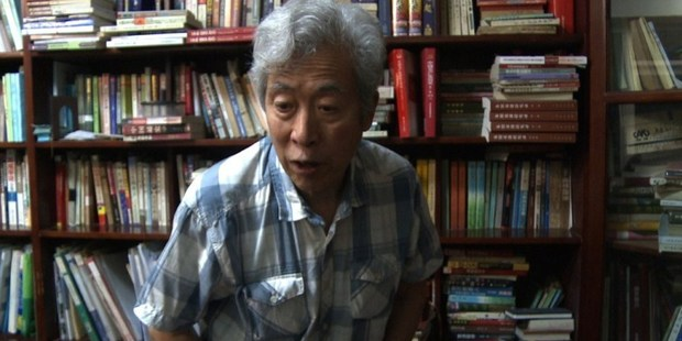 Former professor Sun Wenguang talking in his home in Jinan, east China.
