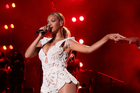 Beyonce was nearly yanked off stage by an overzealous fan. Photo / AP