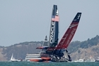 Emirates Team New Zealand, right, nearly capsizes next to Oracle Team USA, left, while heading for the windward mark.