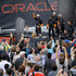 Oracle Team USA crew members celebrate in front of fans after defeating Emirates Team New Zealand during the re-sail of the 13th race of the America's Cup. Photo / AP