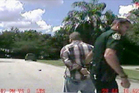 Dash-cam video image released by Police, George Zimmerman is detained by officers. Photo / AP