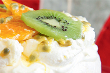 Pavlova with fruit and cream. Photo / Food Hub