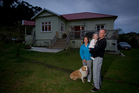 Luke Howard, his wife Ange Howard (L) and their daughter Nellie Howard at their home in Kaukapakapa. The family moved from Birkenhead. Photo / NZ Herald