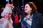 Visually impaired woman Martine Abel feels the head-dress of Emily Collier as part of the touching tour ahead of Tuesday's night's production of Grease at Baycourt. Photo / Joel Ford