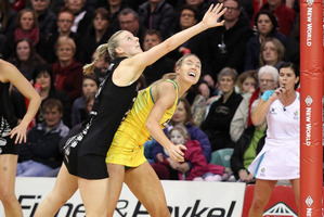Katrina Grant of the Silver Ferns and Caitlin Bassett of Australia compete for the ball. Photo / Getty Images