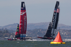 Emirates Team New Zealand lead Oracle towards the first mark before going on to win the first race yesterday morning. Photo / Brett Phibbs