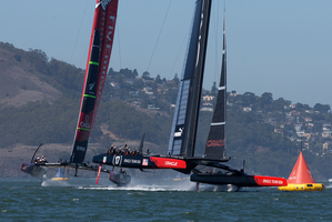 Oracle Team USA gets to the 1st mark ahead of Emirates Team New Zealand, Oracle went on to win Race 12 of the America's Cup. Photo / AP.