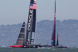 Oracle Team USA lead Emirates Team New Zealand in race 12.  Photo / Brett Phibbs