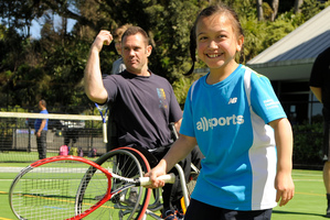 Matakorama Waipouri tries her hand at tennis during the parasport day at St Kentigern School. Photo / Crispin Anderlini