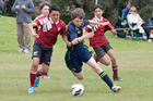 Iman Singh  from Te Puke Intermediate challenges for the ball with Benjamin Woodrow from Aquinas College. Photo / Andrew Warner