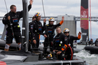 Oracle team USA wave to supporters after beating Emirates Team New Zealand to win Race 13 of the America's Cup, on San Francisco Bay, San Francisco. Photo / Brett Phibbs.