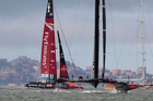 Oracle team USA heads to the finish line a head of Emirates Team New Zealand to win Race 13 of the America's Cup, on San Francisco Bay, San Francisco, California. Photo / Brett Phibbs.