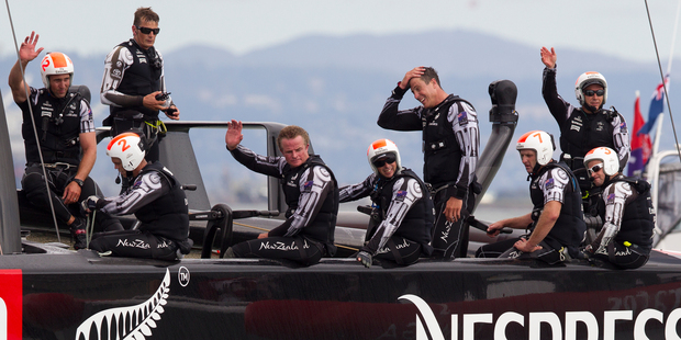 Team NZ crew put a brave face on their disappointment after losing to Oracle in race 13. Photo / Brett Phibbs