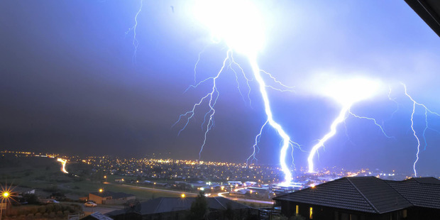Lower Hutt residents are treated to an electrifying sky show during last night's storm. Photo / Resolute Photography