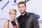 Miley Cyrus and Liam Hemsworth have split after Cyrus' risque performance at the VMAs. Photo / AP