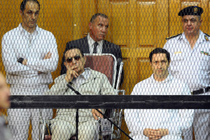 Former Egyptian President Hosni Mubarak, seated, and his two sons, Gamal Mubarak, left, and Alaa Mubarak, right. Photo / AP
