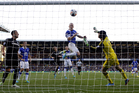 Everton's Steven Naismith, center, scores against Chelsea during the English Premier League soccer match at Goodison Park, Liverpool, England, Saturday Sept. 14, 2013. (AP Photo/PA, Peter Byrne)