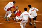 Serbia's Janko Tipsarevic and his teammates celebrate their victory against Canada at the Davis Cup semifinals. Photo / AP