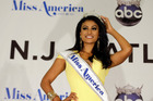 Miss New York Nina Davuluri poses for photographers following her crowning as Miss America 2014.Photo / AP