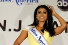 On her first day as the new Miss America, Nina Davuluri dipped her toes into the Atlantic City surf and addressed reporters on her first stop in a slew of media appearances.