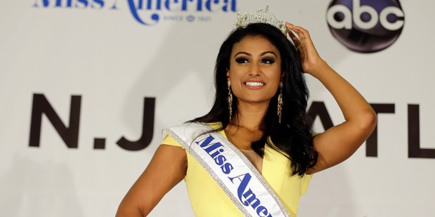 Loading Miss New York Nina Davuluri poses for photographers following her crowning as Miss America 2014.Photo / AP