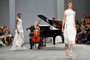 Models wear designs from Erdem at London Fashion Week. Photo by Richard Chambury/Invision/AP Images