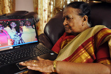 89-year-old Vege Koteshwaramma, looks at the photograph of her granddaughter Nina Davuluri, the first contestant of Indian origin to become Miss America.Photo / AP