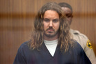 Tim Lambesis, 32, front man for the Christian-inspired heavy metal group As I Lay Dying, appears in Vista Superior Court in California. Photo / AP