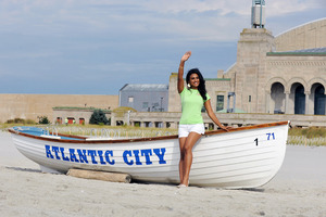 Miss America Nina Davuluri poses on the beach during the traditional dipping of the toes in the Atlantic Ocean after being crowned Miss America.Photo / AP