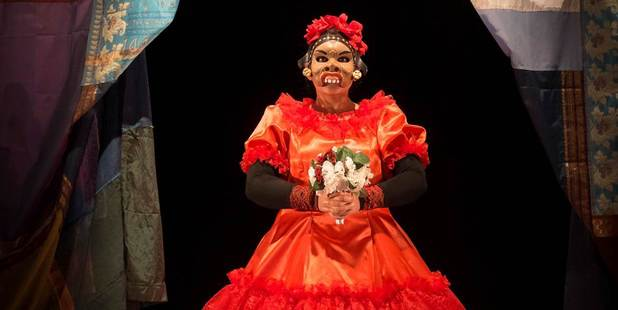 Nisha Madhan in  Kiss the Fish , a production that pays homage to Balinese comic mask traditions with a bizarre menagerie of exotic characters.