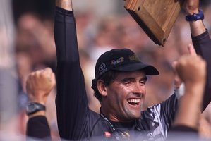 Russell Coutts holds the cup aloft after beating Prada 5-0 in the 2000 America's Cup Challenge series. It's hard to see cup racers returning to slower monohulls. Photo / APN