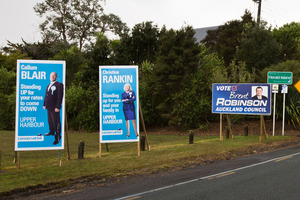 Candidates' billboard photos make them look shifty and desperate. Photo / Greg Bowker
