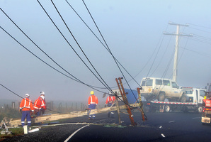 Linesman fix a power line. File photo /  Ben Fraser