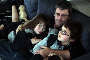 Richard Todd at home with daughters Brooke, 7, and Caitlin, 6. Photo / Doug Sherring