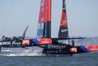 Emirates Team New Zealand heads toward the finish line to win the tenth race of the America's Cup sailing event against Oracle Team USA. Photo / AP