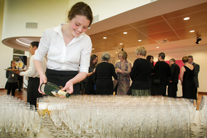 Annika Brennan of Napier Girls High pours bubbles for guests at the MTG cocktail party to start the launch of the opening weekend for the new complex, Napier.