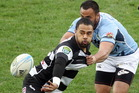Telusa Veainu offloads in the tackle of Northland's Viliami Tahitu'a at McLean Park. Photo / APN