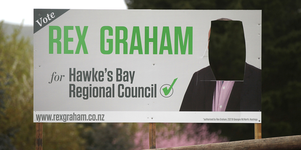 """Two mayoral candidates and at least one regional council candidate have had their faces literally cut off their billboards."""