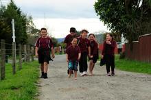 Ruatoki school-children make their way home. Photo / Peter Quinn