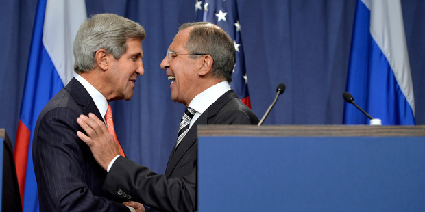 U.S. Secretary of State John Kerry, left, shakes hands with Russian Foreign Minister Sergei Lavrov, right. Photo / AP