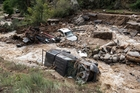 The destructive floods took out homes, cars, trees, and completely washed out Gold Run Rd, north of Boulder. Photo / AP