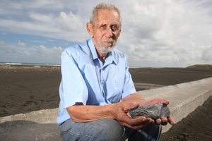 MAN OF THE SEA: Potonga Neilson with adze, which was found in the dunes. Photo / FILE