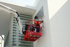 Contractors at work yesterday putting the finishing touches to exterior signage and lighting. Photo / Paul Taylor