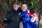 Ninjas Paul Holmes (left) and Daniel Welton at Oracle owner Larry Ellison's San Francisco home, which they decorated with New Zealand flags. Photo / Brett Phibbs