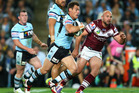 John Morris of the Sharks runs the ball during the NRL First Semi Final match between the Manly Sea Eagles and the Cronulla Sharks. Photo / Getty Images.