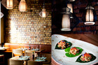 Interior detail of restaurant Mekong Baby in Ponsonby and the Crab Betel Nut Leaves currently on the menu. Photo / Babiche Martens
