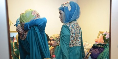 Contestants of the Muslimah World pageant prepare backstage for the grand final of the contest in Jakarta. Photo / AFP