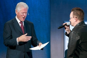 Bill Clinton (left) arrives on stage as Bono impersonates him at the Clinton Global Initiative in New York yesterday. Photo / AP